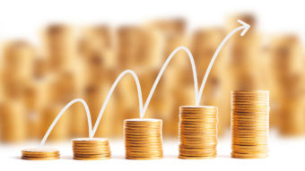 Rows of gold coins for finance and banking concept with arrow graph