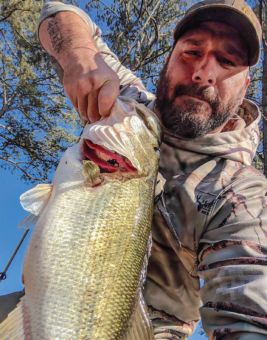 Iraq War veteran and outdoor enthusiast Daniel Tingle caught this large bass while fishing in Georgia. Photo Courtesy of Daniel Tingle