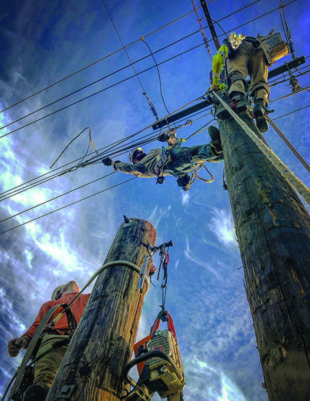Journeyman Lineman Dan Feliz goes horizontal as he and fellow crew members complete a job for a line construction contractor in Oregon. PHOTO BY JUDE JOLMA