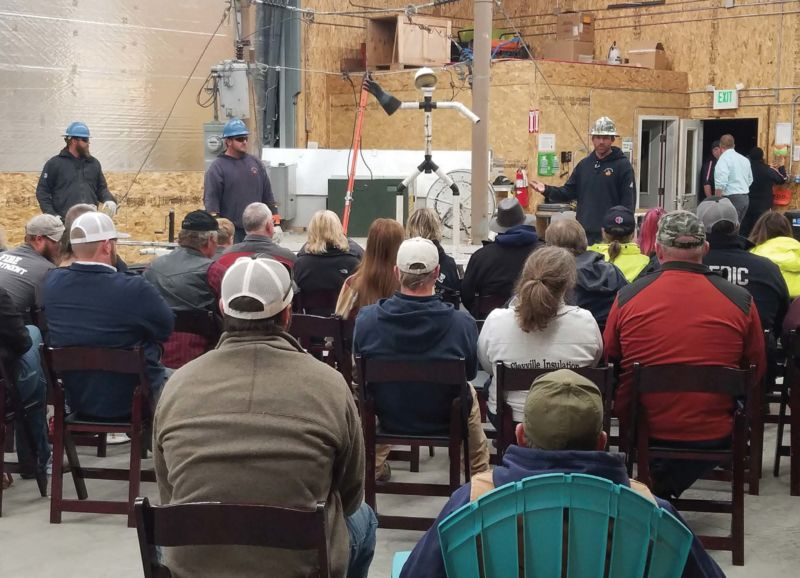 Raft River Electric linemen KC Ramsey, Tracy Bankhead and Kenneth Loughmiller talk with Lifeflight personnel and emergency responders about being aware of surroundings and keeping their safety in mind first. Photo courtesy of Raft River Electric