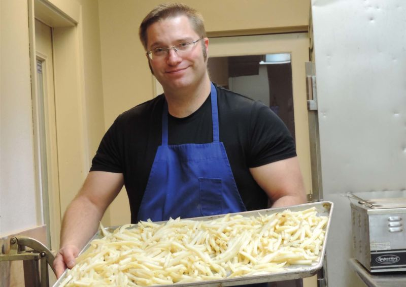 Dan Taylor shows off Black Pine Steakhouse french fries. He and his wife, Holly, learned the secret to fries with a lasting crunch.