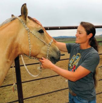 Shanna grooms El Gato, a horse she trained as a youngster. Photo by Dianna Troyer