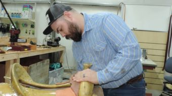 Bryce Williams concentrates on building a saddle, which is sold in the store.
