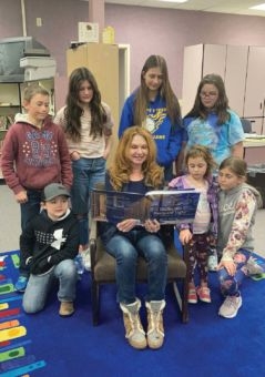 Carla reads to children at Raft River Elementary School.